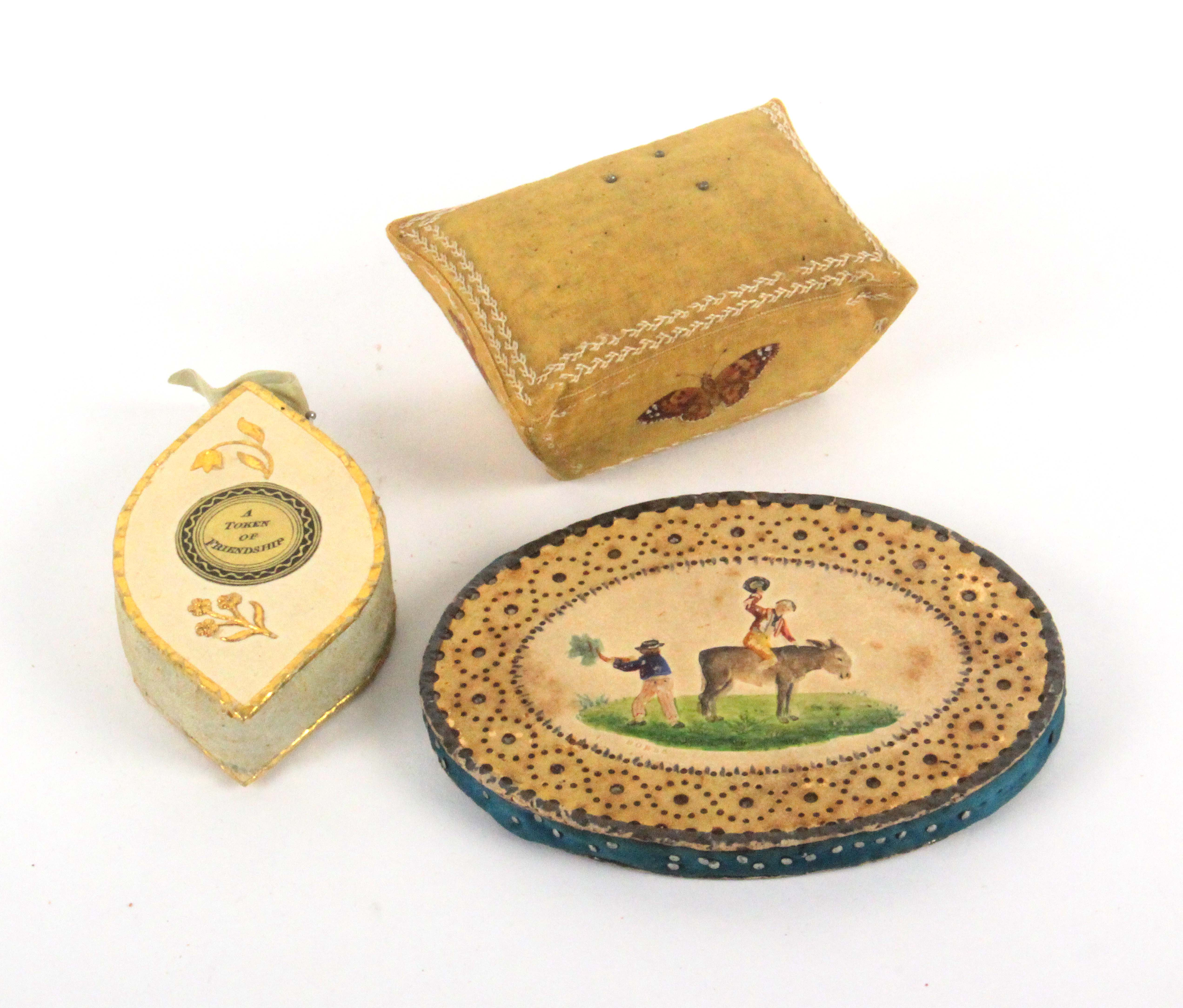 Three early 19th Century pin cushions, comprising an oval Bristol card example one side with a