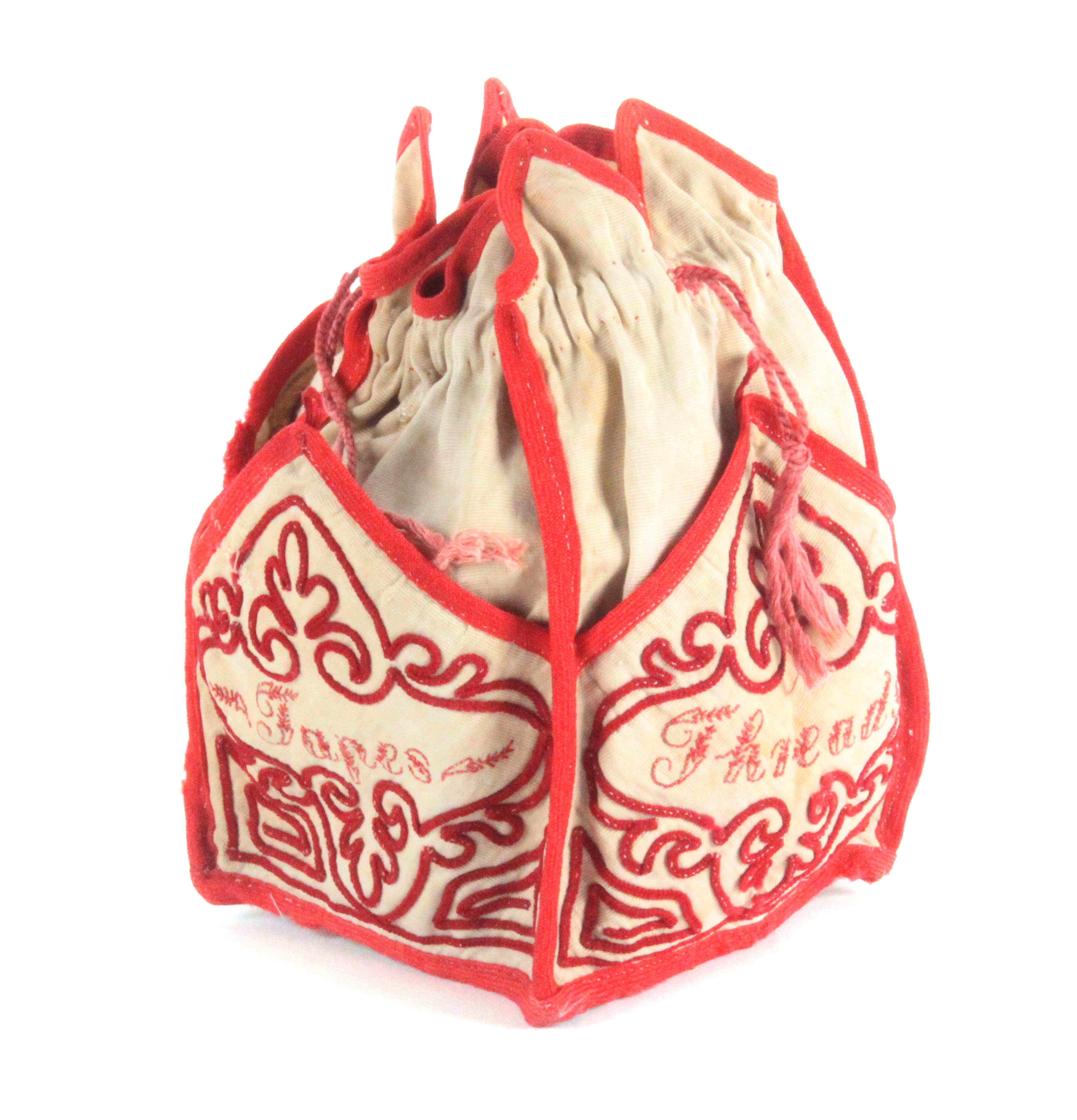 An attractive early 19th Century embroidered sewing bag, of square section in cream cloth edged in