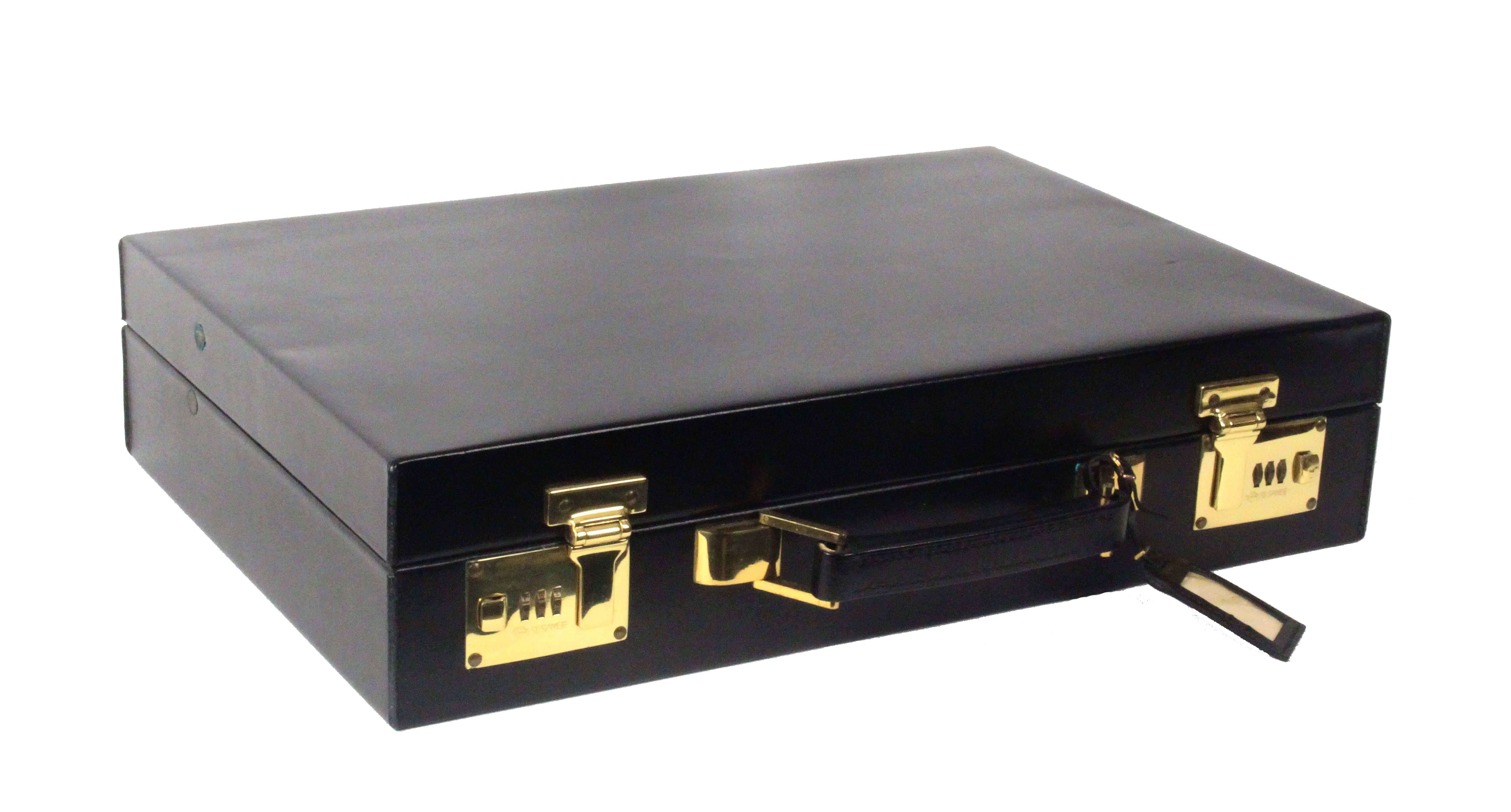 Asprey - London, a black leather attache case, unused, rectangular, brass Sesamee combination