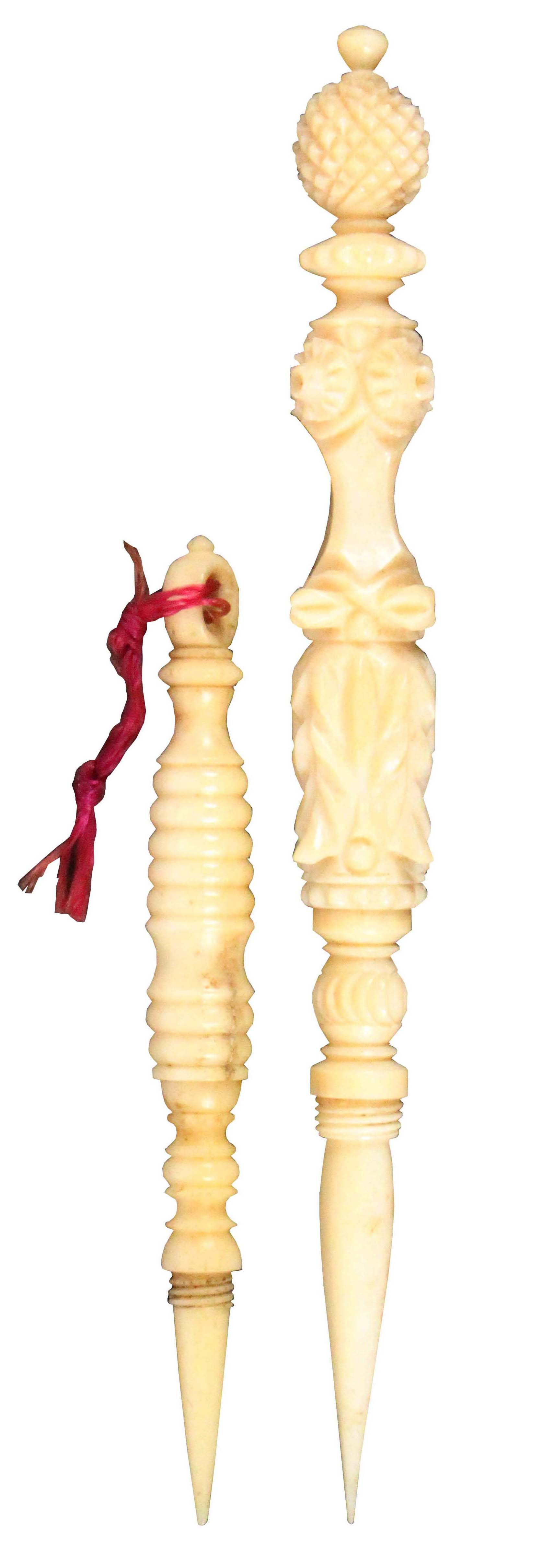 Two 19th Century ivory reversible stilettos, comprising a leaf carved example with pineapple finial,
