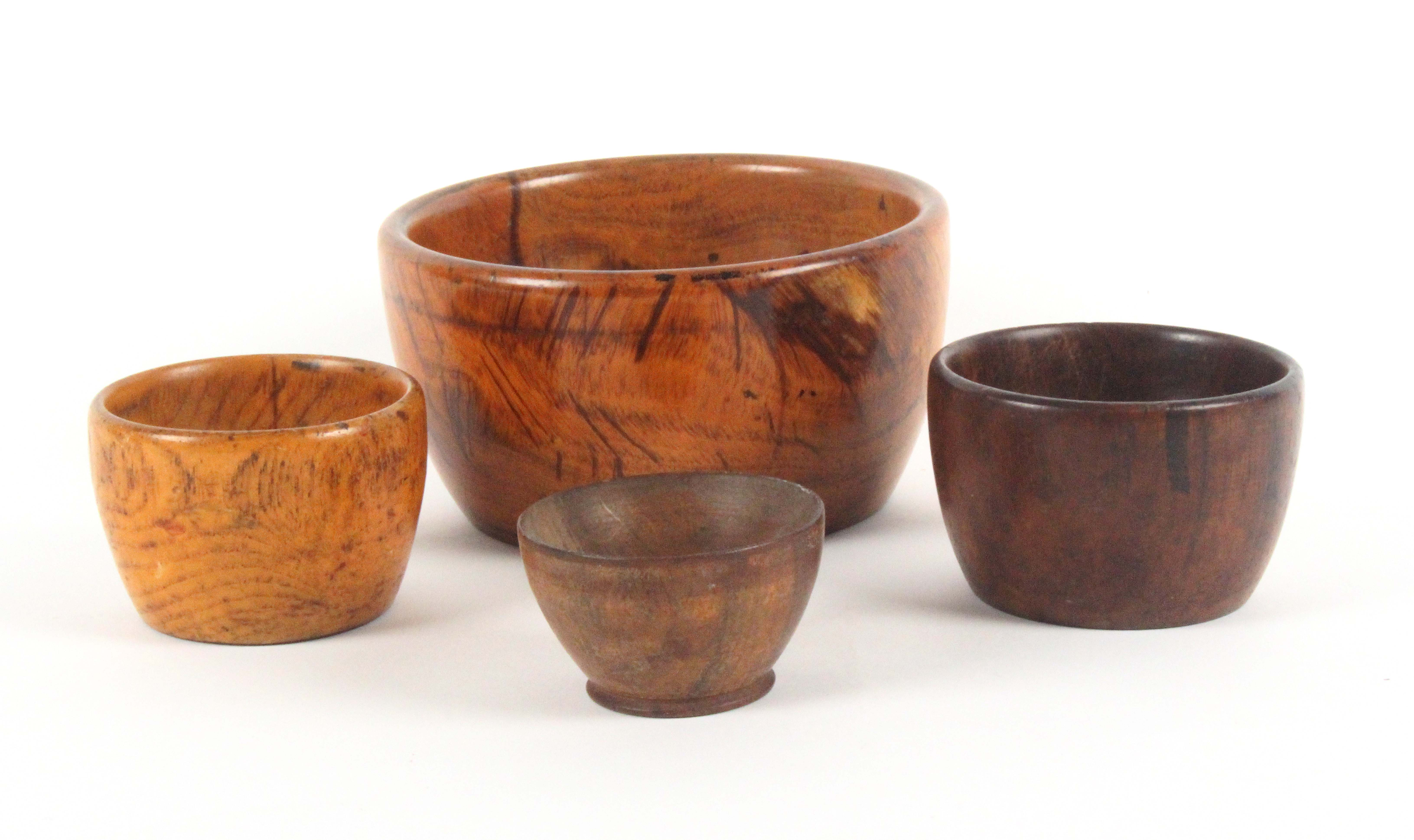 Four 19th Century wooden wool ball bowls, comprising a large lignum vitae example, 13cms, and - Image 2 of 2