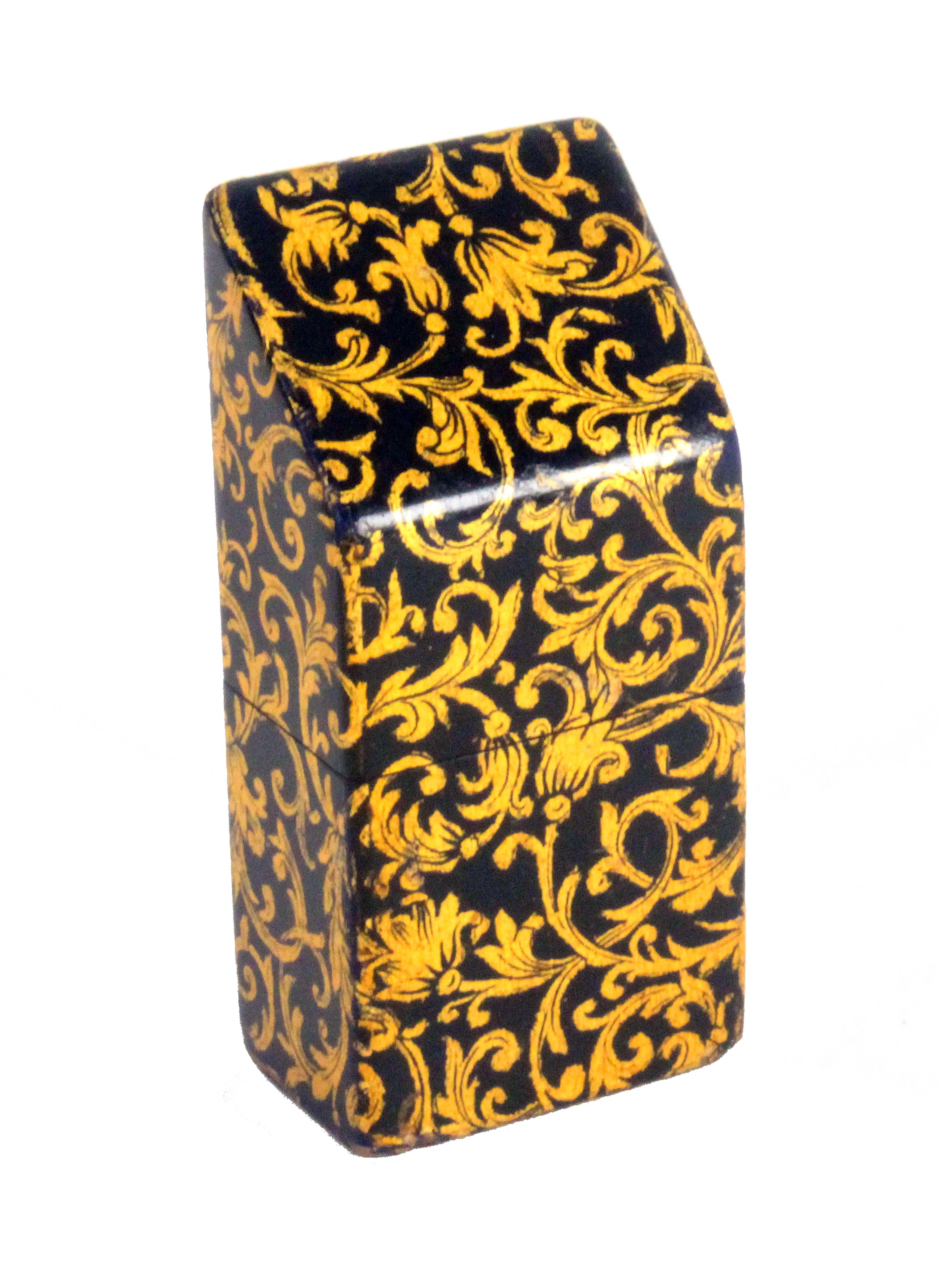 A fine Mauchline ware slant top needle packet box, decorated all over in gilt on a black ground with