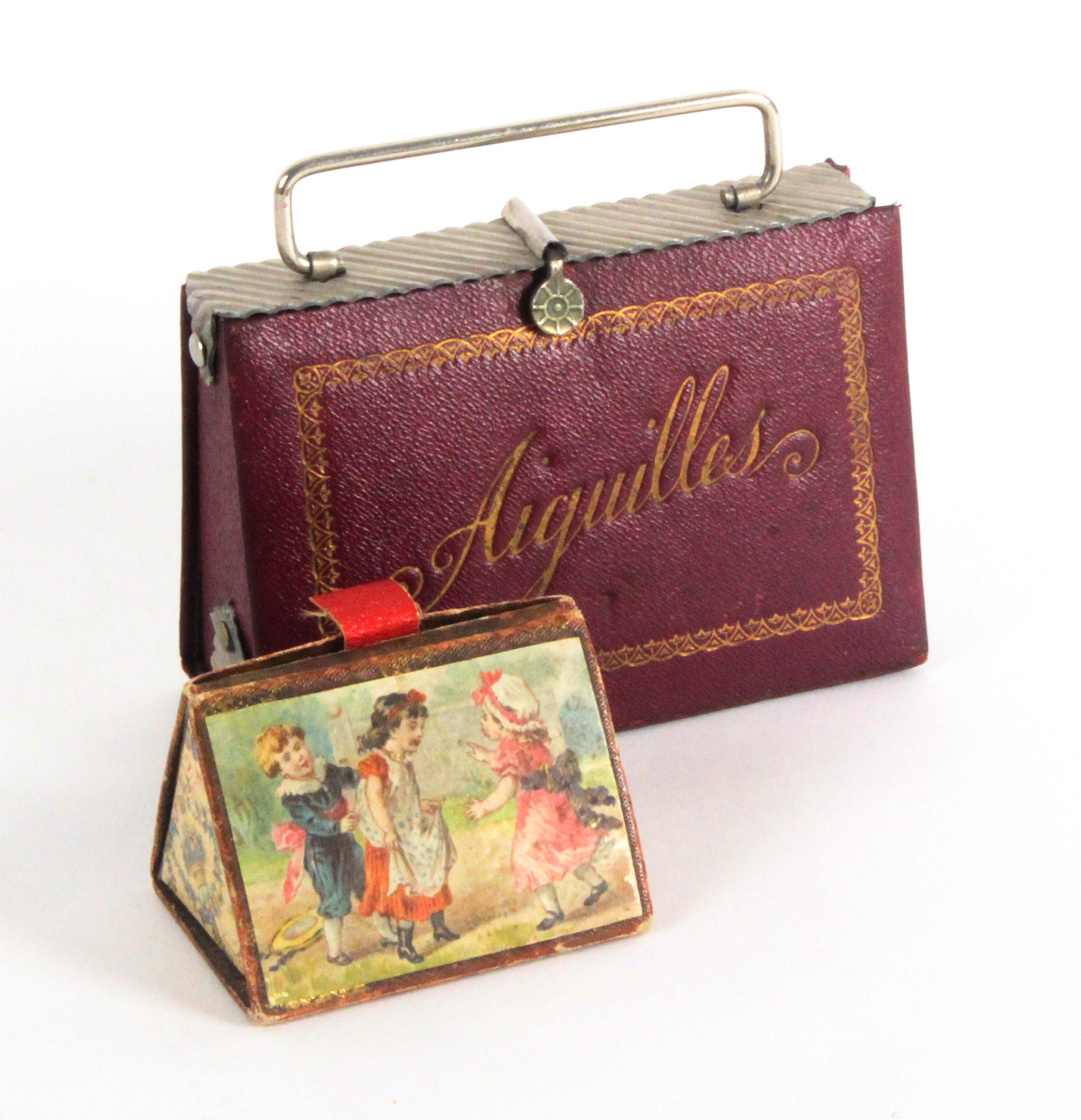Two needle cases, comprising a cardboard example 'The Cottage Needle Case', with registration date