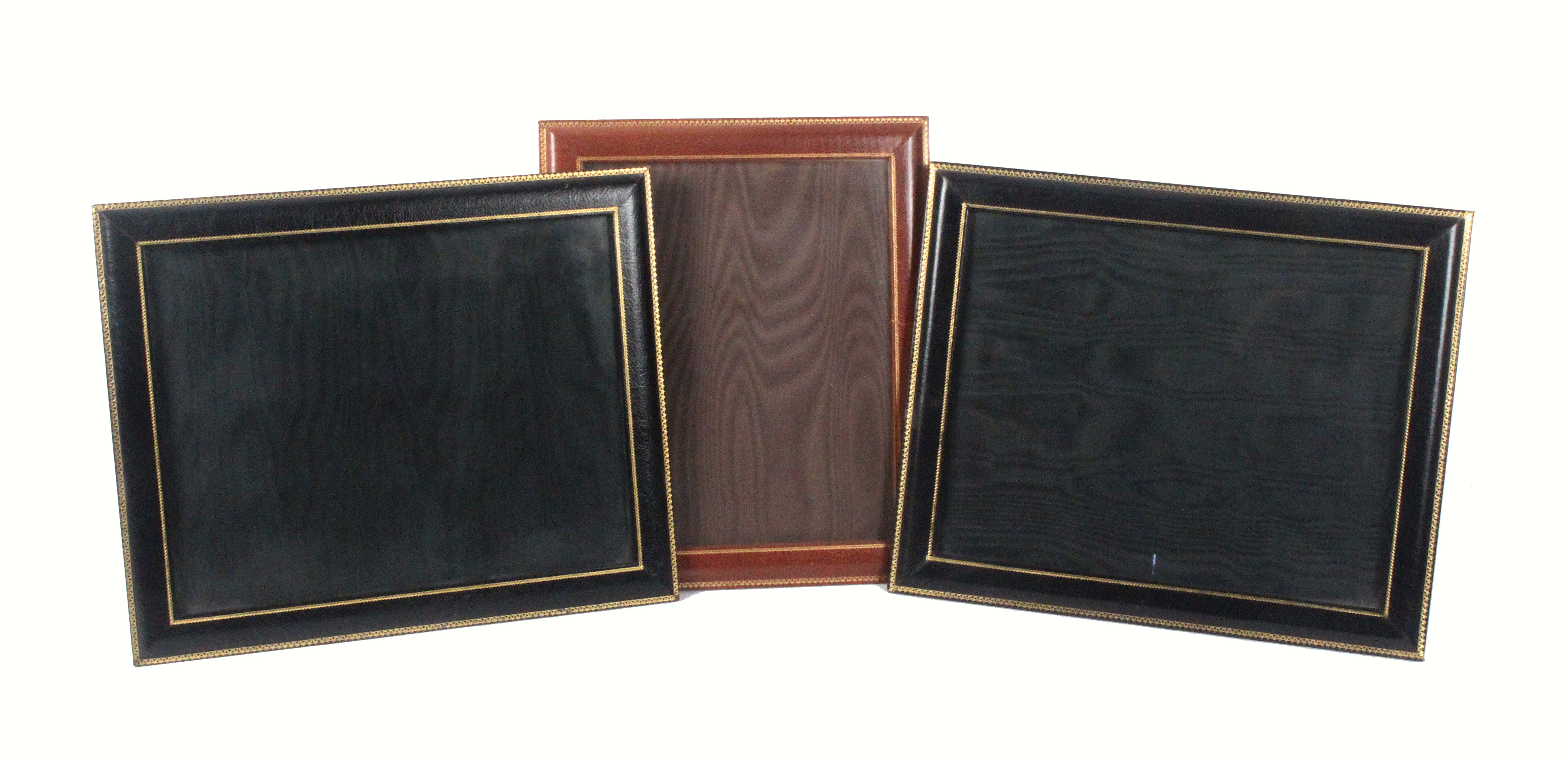 Asprey - London, six gilt tooled leather rectangular frames, comprising a pair in black, 29 x 35cms,