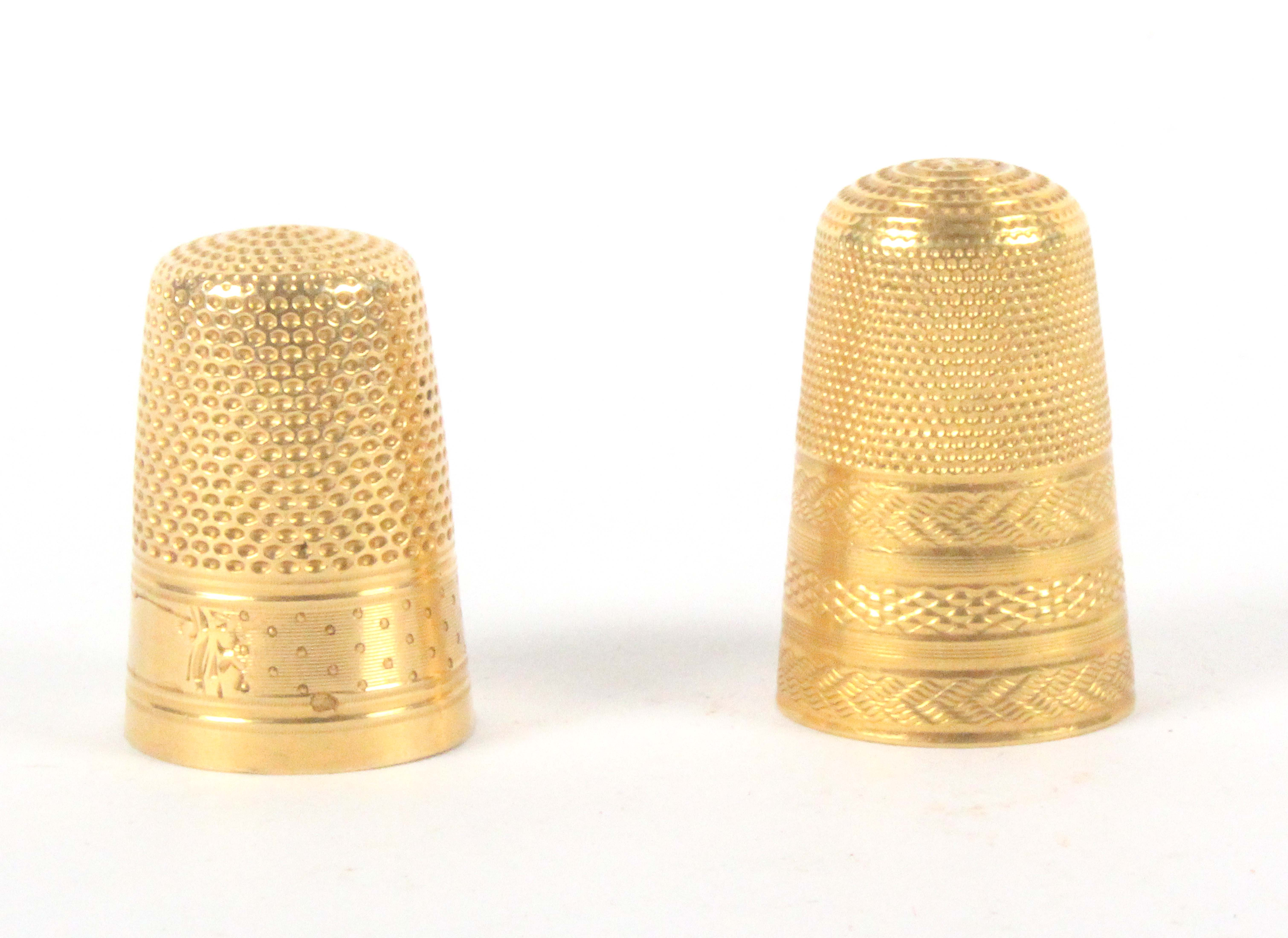 Two gold thimbles, comprising a French example with line and dot frieze to a vacant cartouche, the