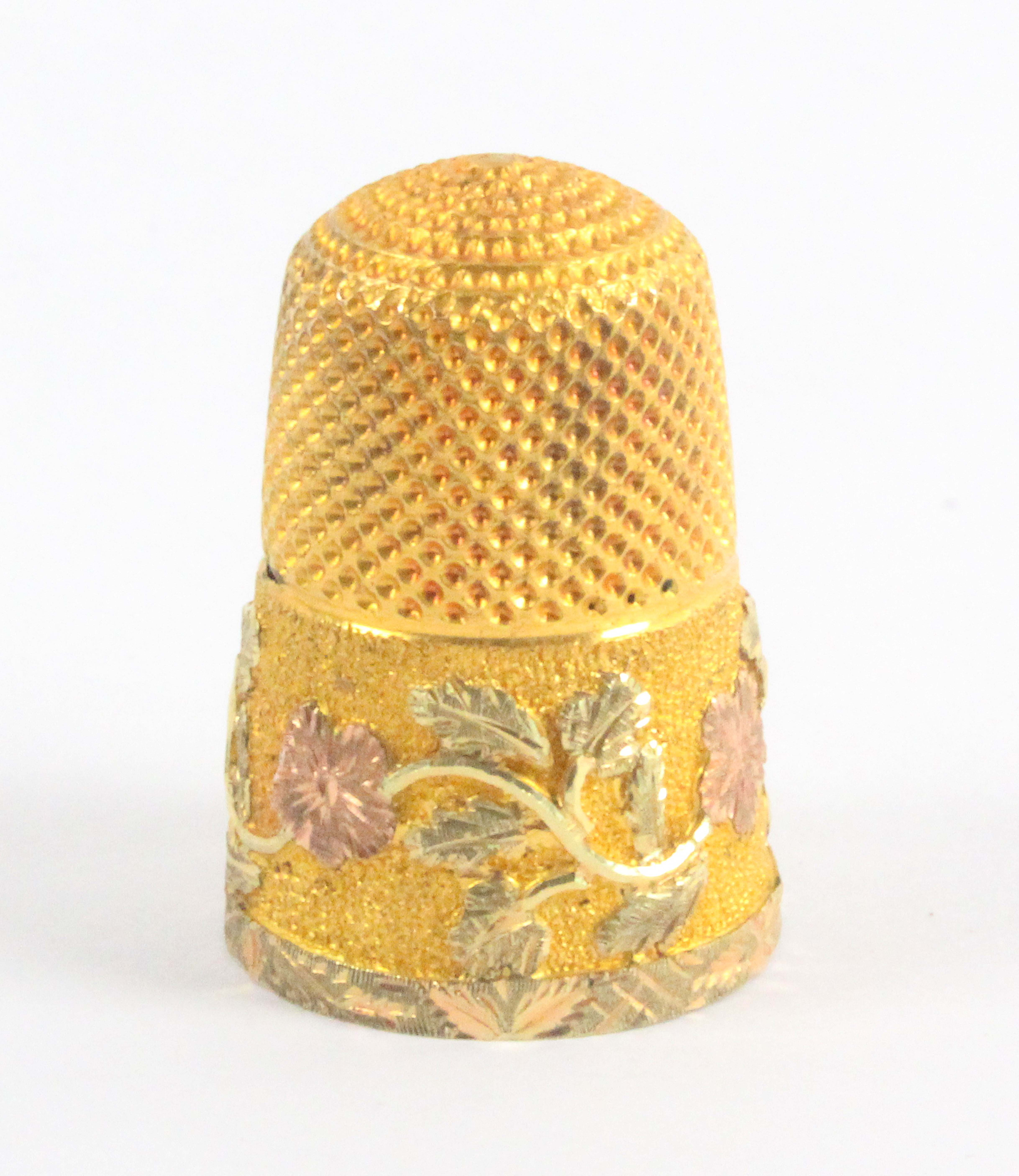 A Victorian three colour gold thimble, the frosted frieze with a cartouche initialled 'AW' and - Image 2 of 2