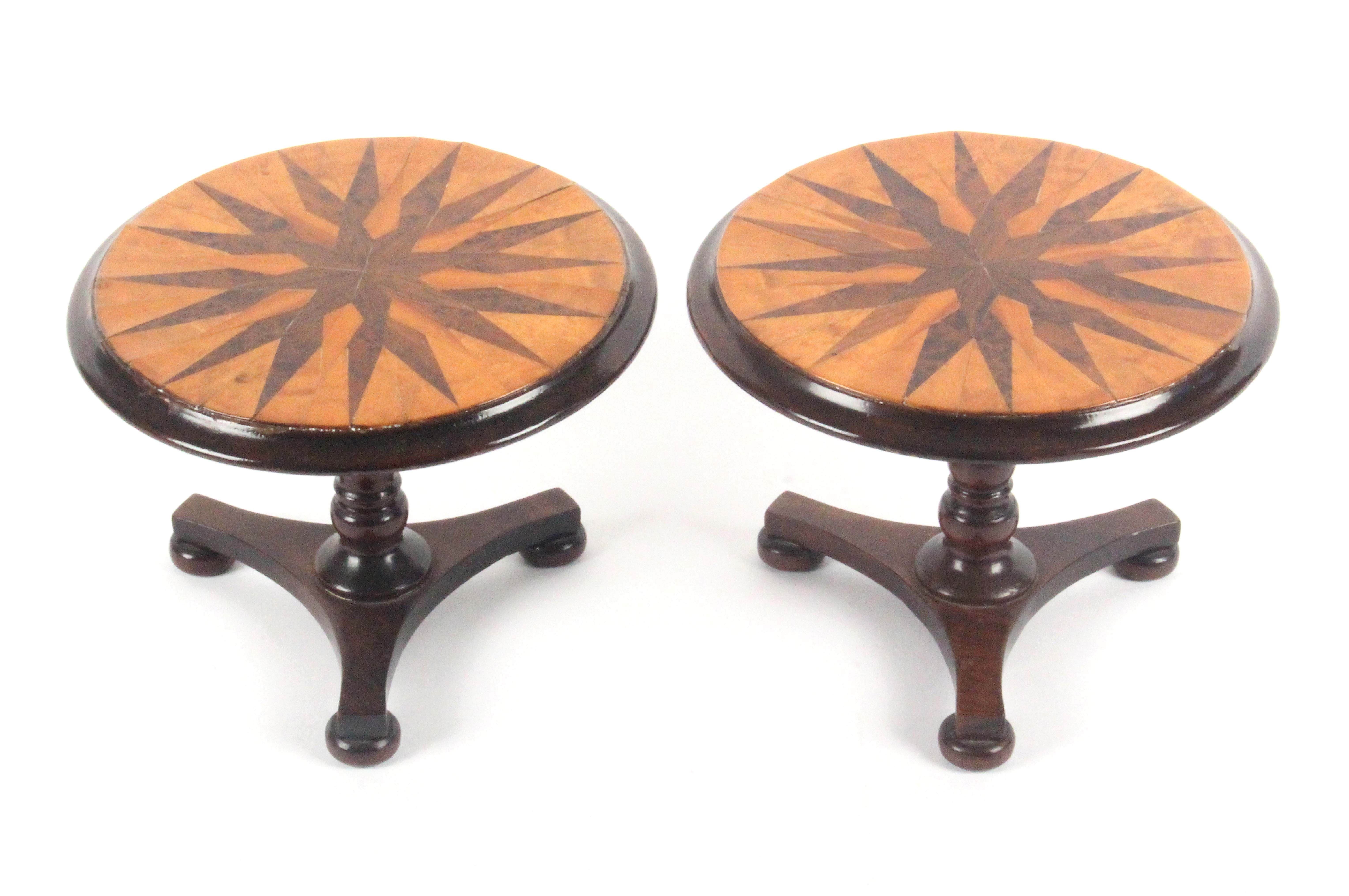A pair of rosewood miniature circular tilt top tables, each with a tri-form base and three bun - Image 2 of 3