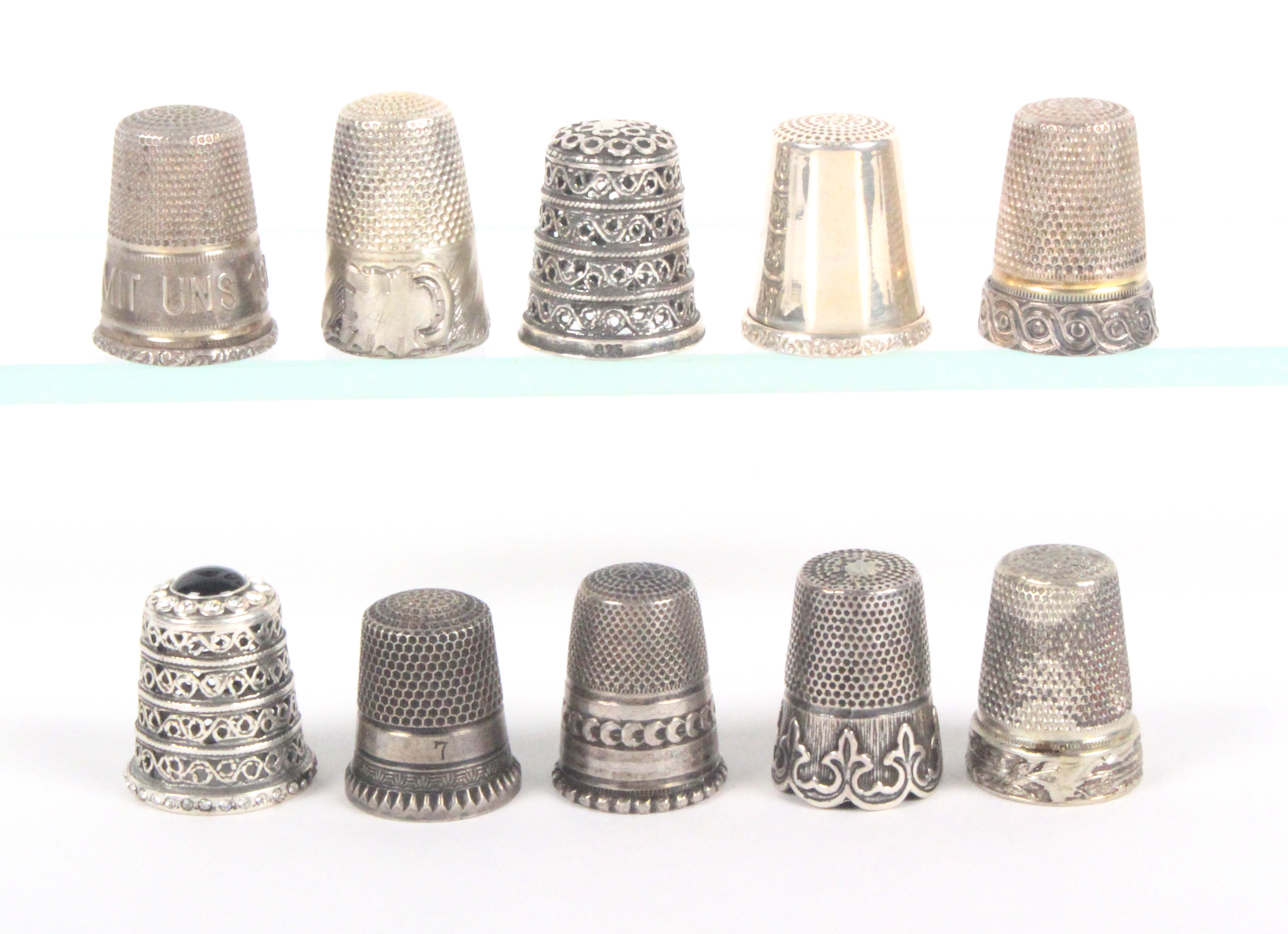 Ten 19th Century and later continental silver thimbles, including one with frieze inscribed 'Gott