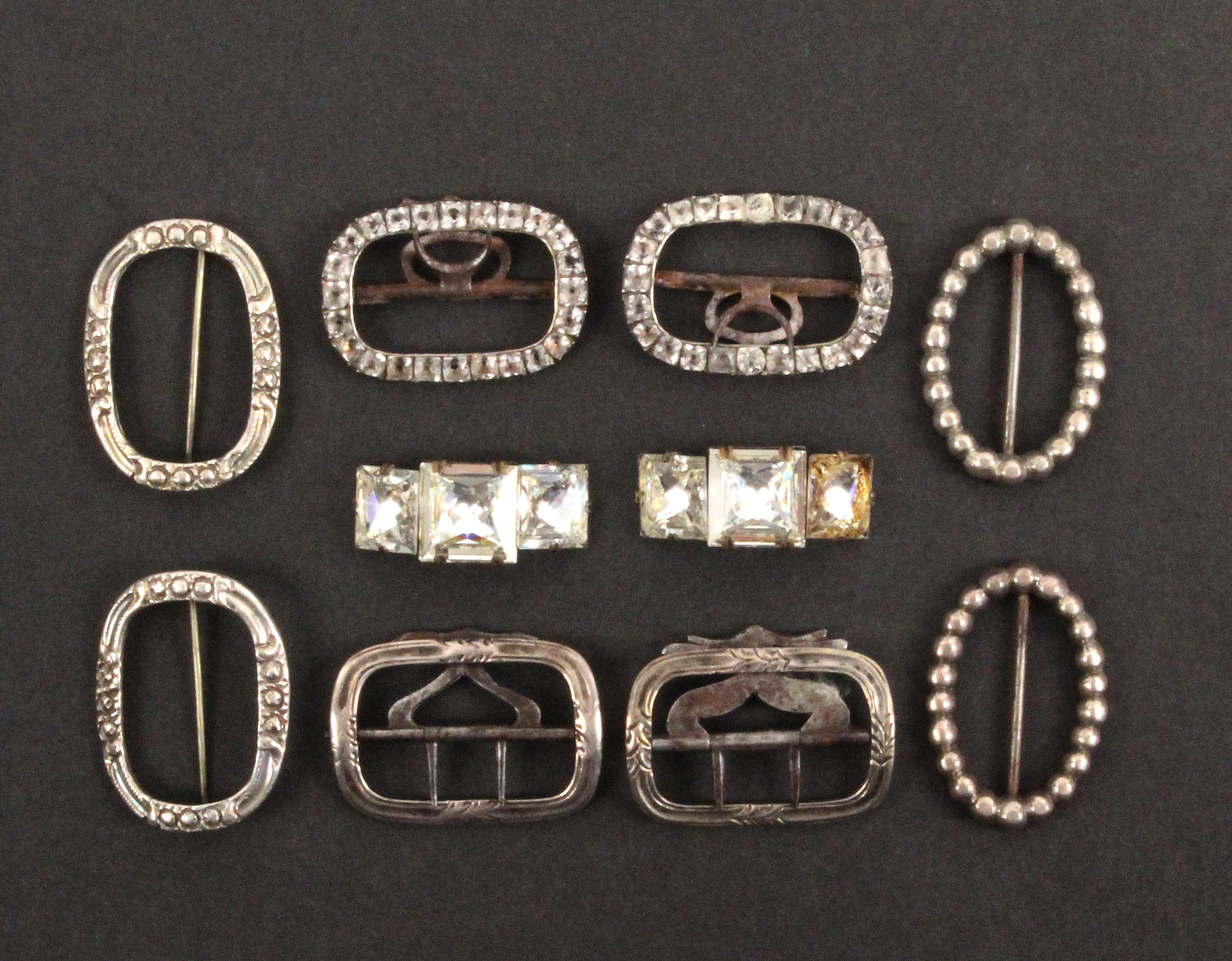 Five pairs of silver mounted small shoe buckles, comprising an oval pair with hinged pin fixings,