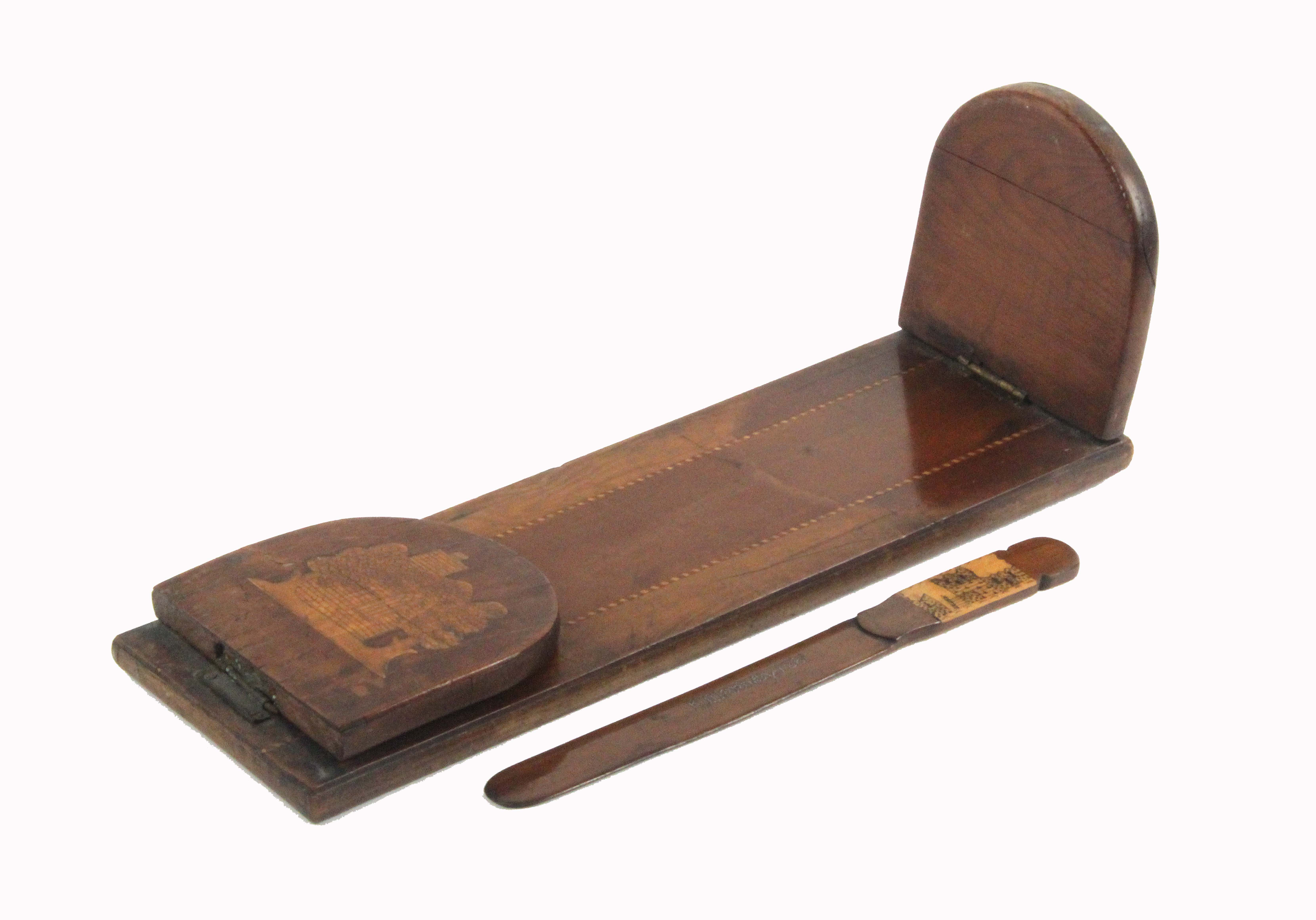 A mid 19th Century Killarney ware arbutus wood book retainer and a paper knife, the first with
