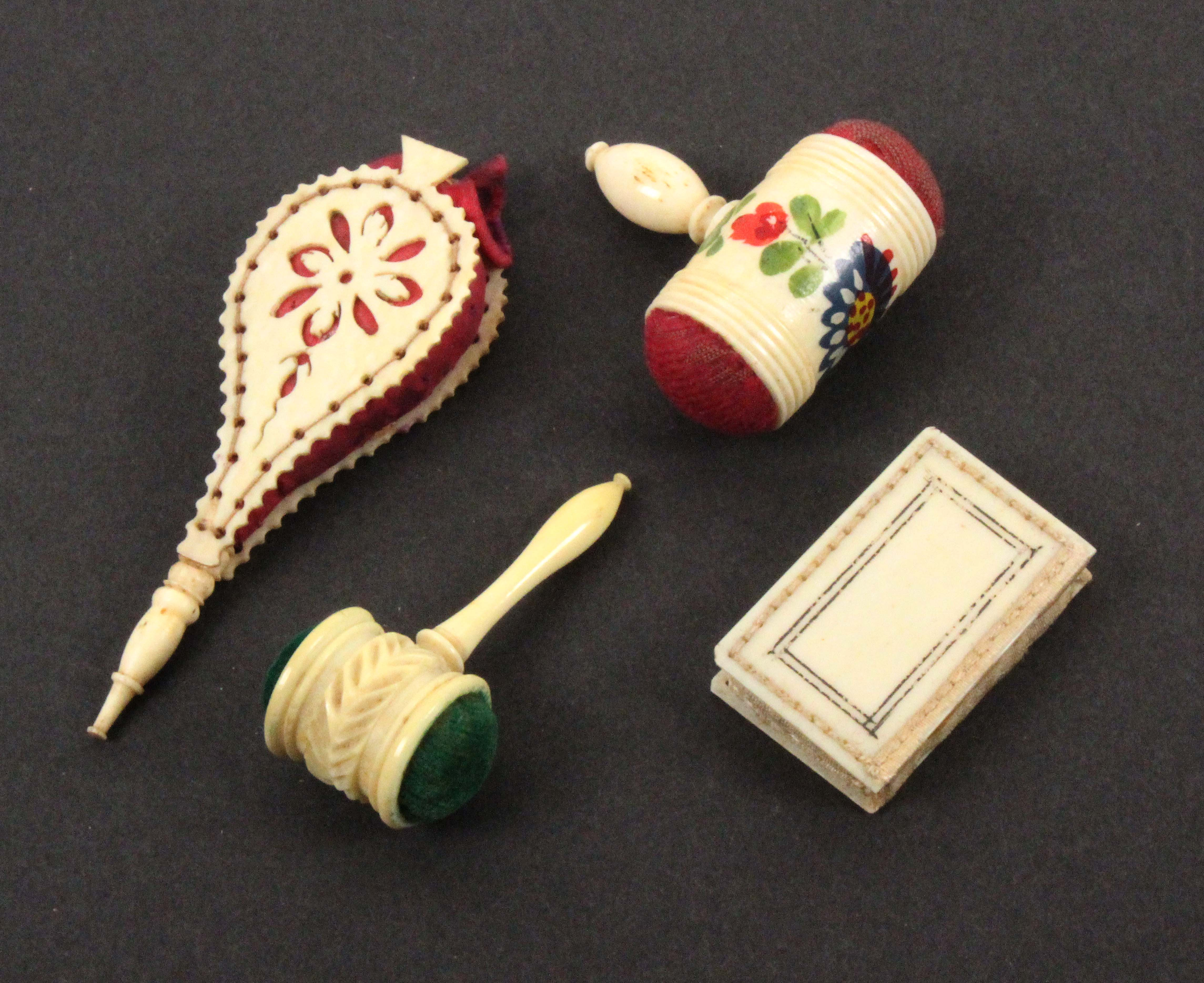 Four 19th Century ivory and bone pin cushions, comprising two gavel form examples, one with floral