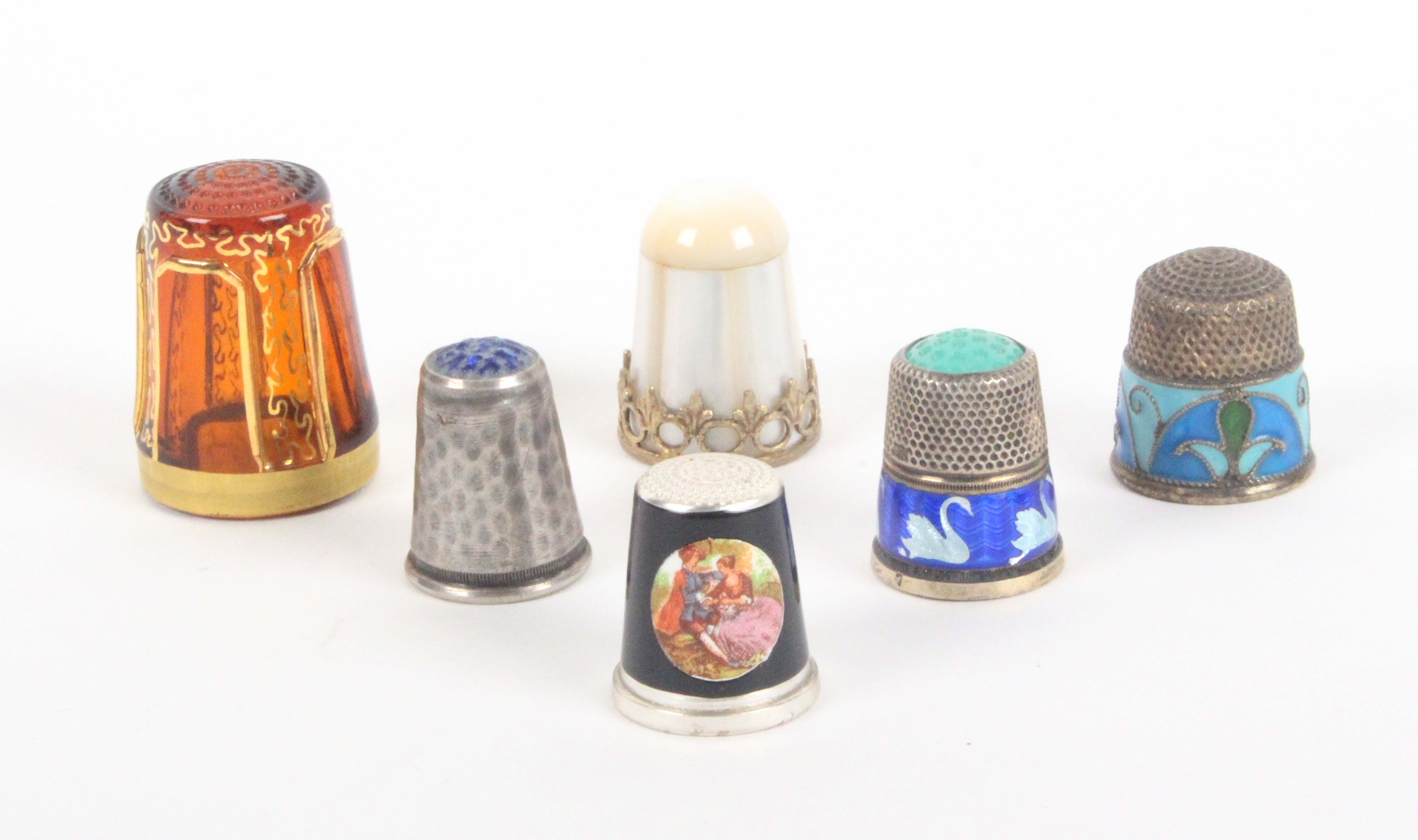 Six 20th Century thimbles comprising, a Bohemian glass example with gilt overlay, a mother of