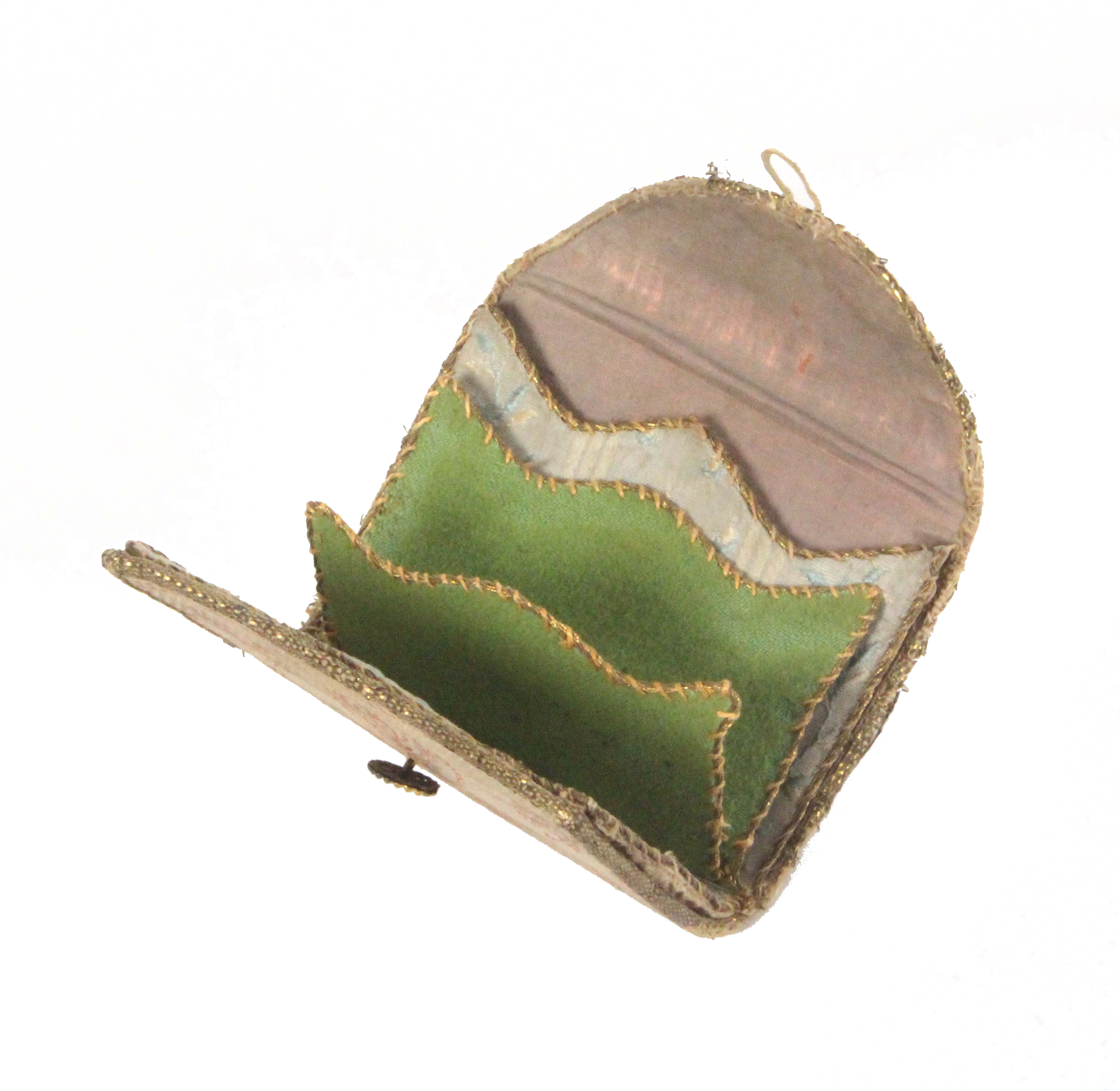 An 18th Century ivory silk sewing wallet, with anthemion and floral printed or painted decoration,