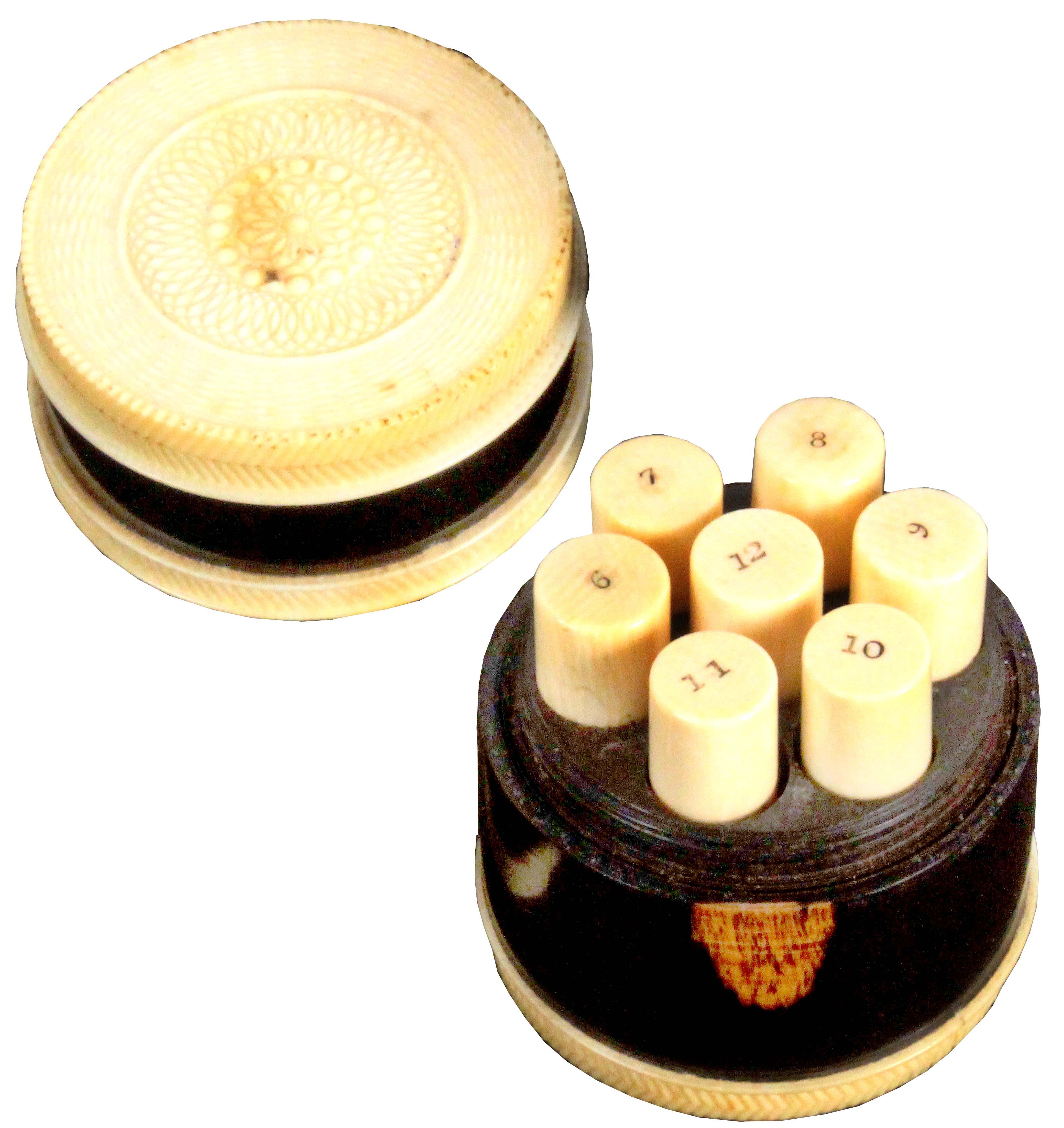 A fine early 19th Century lignum vitae and ivory mounted multiple needle box, of cylinder form