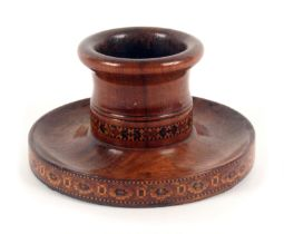 A rosewood Tunbridge ware vesta or spill holder, the dished circular base with geometric border