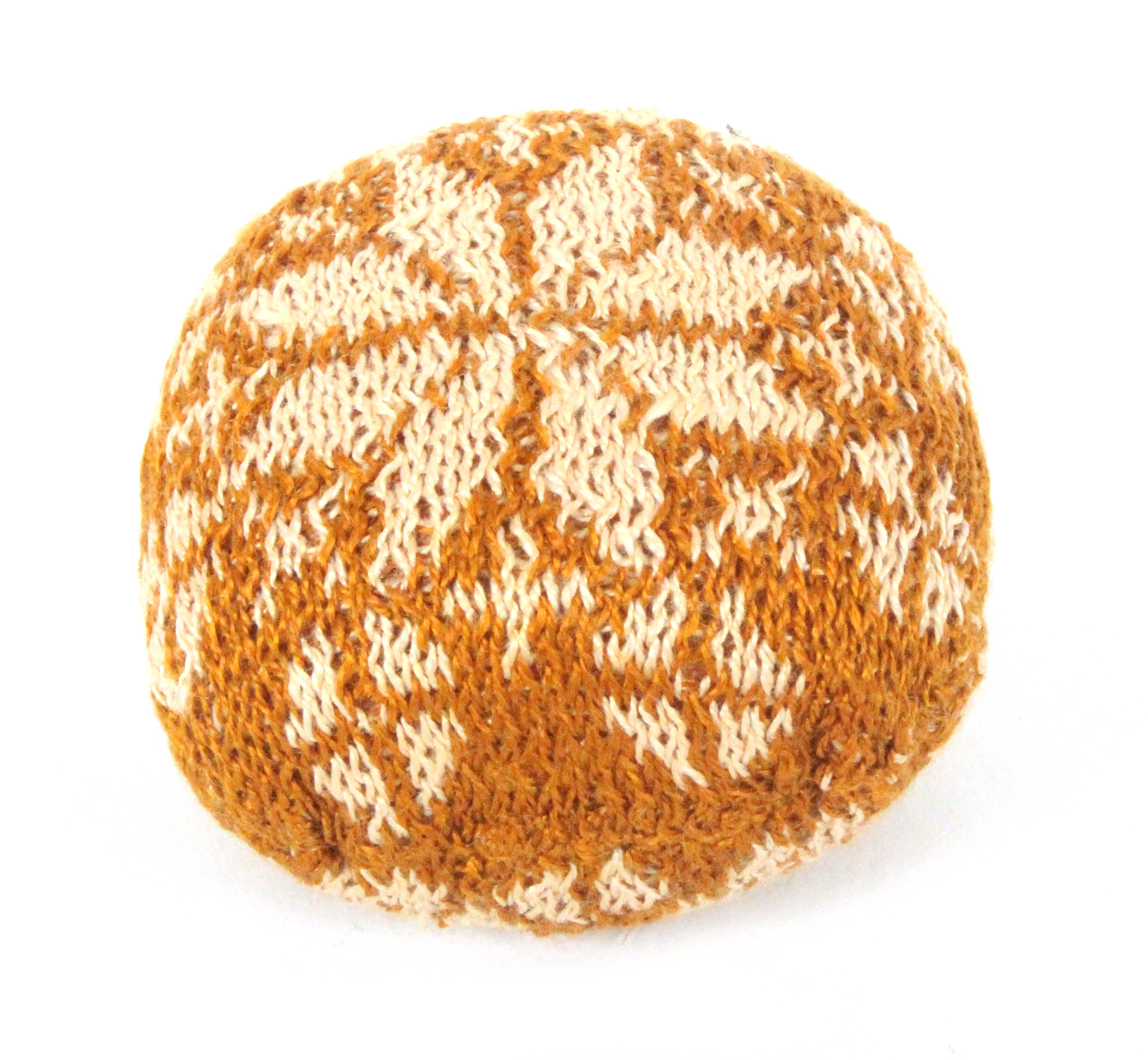 A late 18th Century/early 19th Century knitted pin 'ball', of near square form worked with a