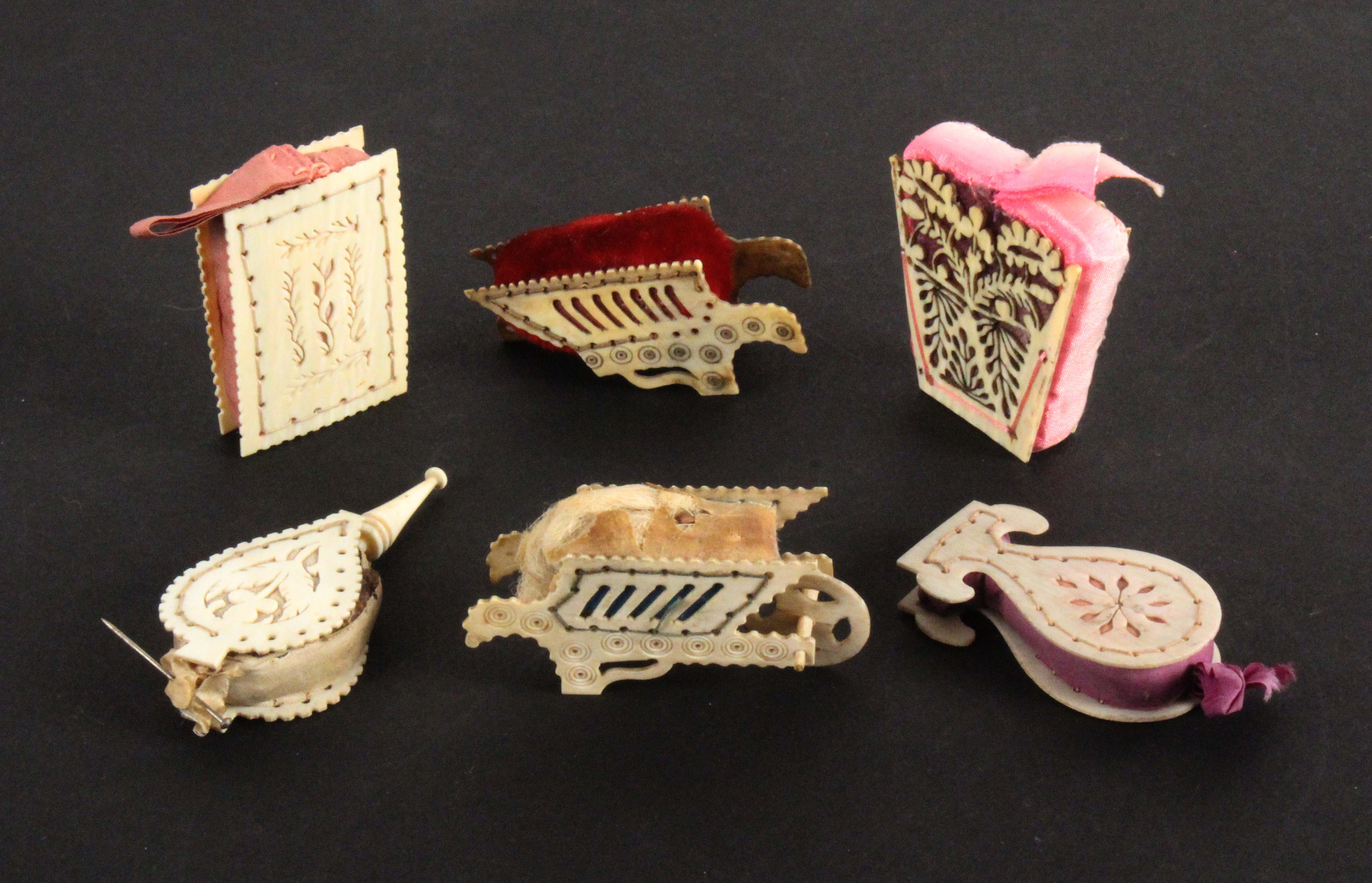 Six pierced bone and ivory pin cushions, comprising a set of bellows, 6cms, a hot air balloon with