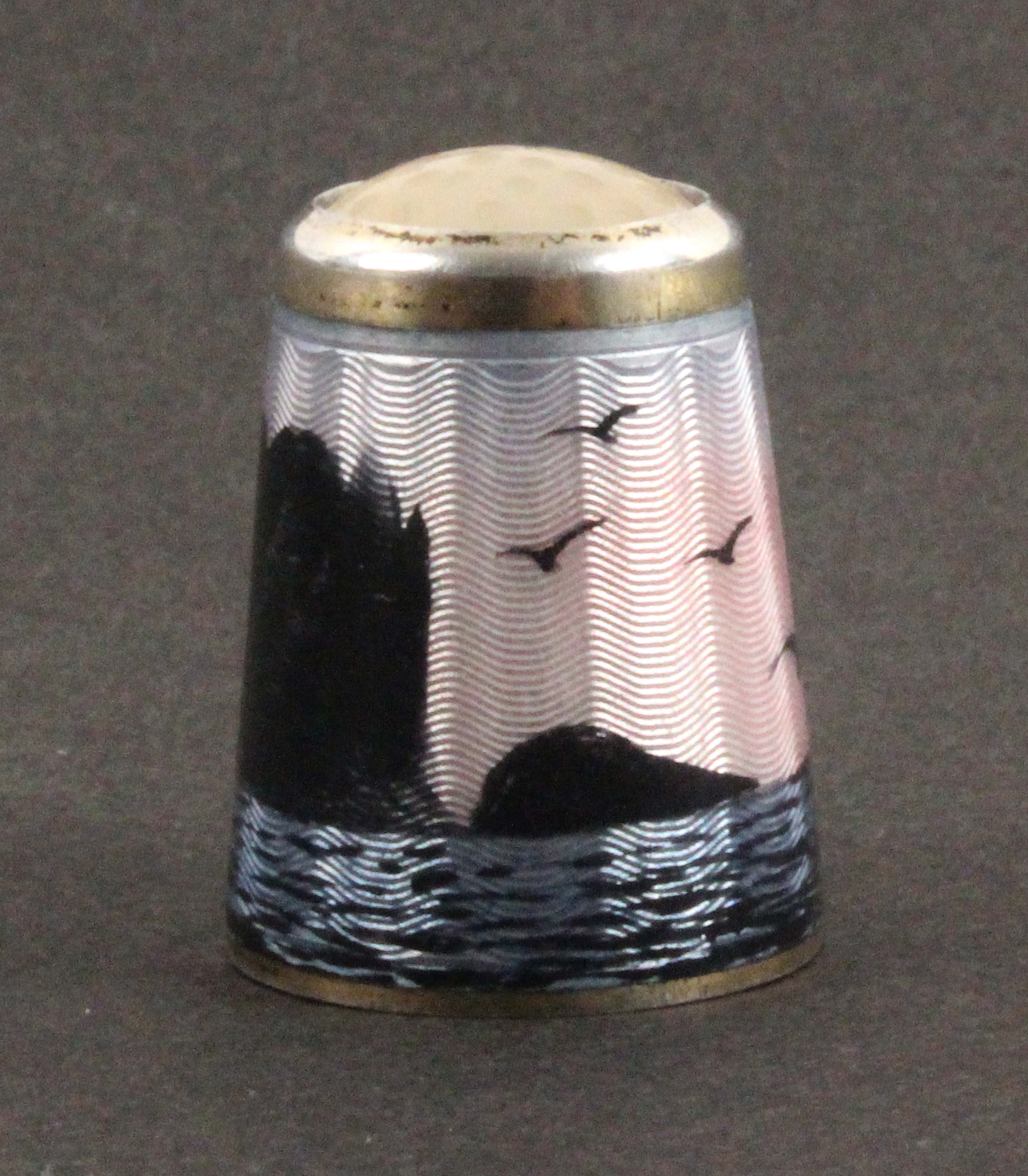 A Norwegian silver and enamel thimble, depicting North Cape with birds in flight over waves below - Image 2 of 2