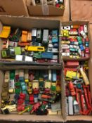 Quantity of loose Die Cast vehicles, toys etc., in four boxes