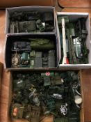 Quantity of loose Die Cast military vehicles etc., in four boxes