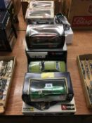 A quantity of individually boxed Burago and Maisto Die Cast cars (9)