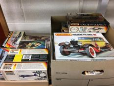 Two boxes of Matchbox model kits