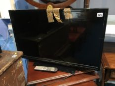 """Isis 31"""" flatscreen TV, with remote and instructions"""