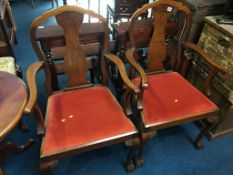 Pair of walnut ball and claw carver chairs