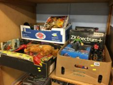 Four boxes of assorted vintage toys