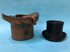 A top hat and leather case