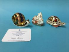 Three Royal Crown Derby paperweights, rabbit and snail with gold stoppers, turtle with silver