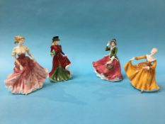 Four Royal Doulton figures 'Christmas Day 2006', 'Stephanie' (signed), 'Festive Wishes', and '