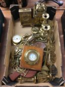 Assorted brassware including silver pocket watch in a brass mount, candle sticks etc.