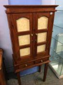 Modern hardwood cabinet on stand