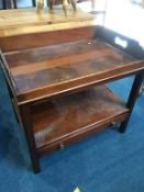 A reproduction mahogany side table, with lift off tray top