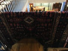 A Hamadan rug, the midnight blue ground with geometric floral motifs and main tree design border.