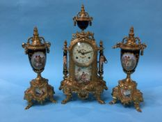 A reproduction gilt metal mantle clock and garniture
