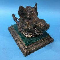 A brass inkwell, modelled as a Boars head