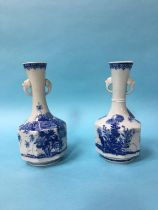 A pair of blue and white Oriental vases