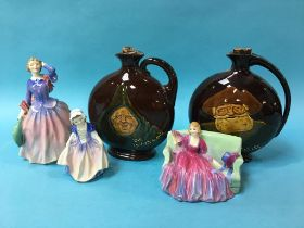 Three Royal Doulton figures and a pair of Royal Doulton Dewar's Whiskey decanters