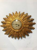A Sunburst giltwood wall clock
