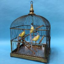 A Genykage bird cage with porcelain feeders