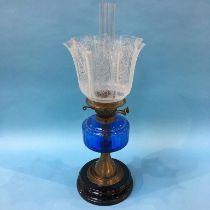 An oil lamp with blue glaze reservoir