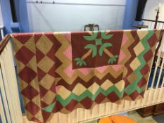 A Durham quilt in green, beige and maroon