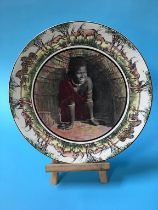 A Royal Doulton charger African series stand