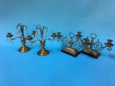 Two pairs of modern brass candelabras