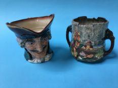 A Royal Doulton Toby jug and 'Wandering Minstrel' jug