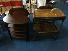 An oak tea trolley and an occasional table