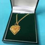 A 9ct gold necklace and pendant, 10g