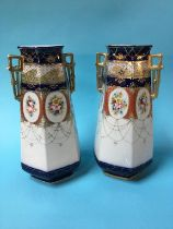 A pair of gilded Edwardian vases decorated with panels of flowers